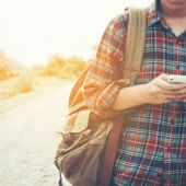 man traveling alone using phone
