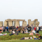 A view of the standing stones at Stonehenge with summer solstice celebration