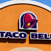 A street view of a Taco Bell restaurant logo in California.