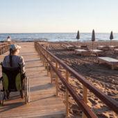 Woman in wheel chair on boardwalk