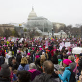 A view from a crowd of marchers at the Women's March in Washington, D.C., with the Capitol building.