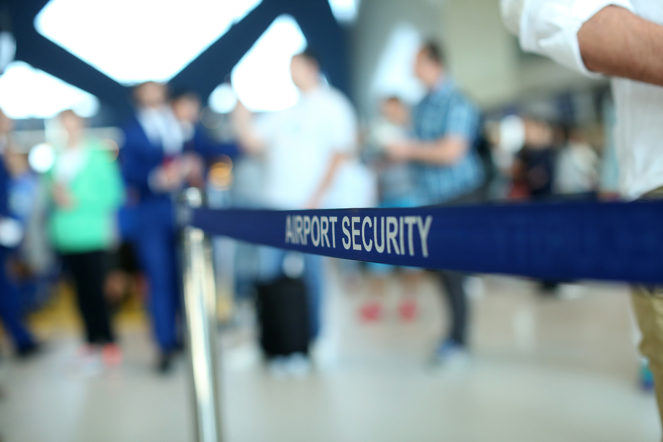 "A sign reads ""airport security"" at an airport."