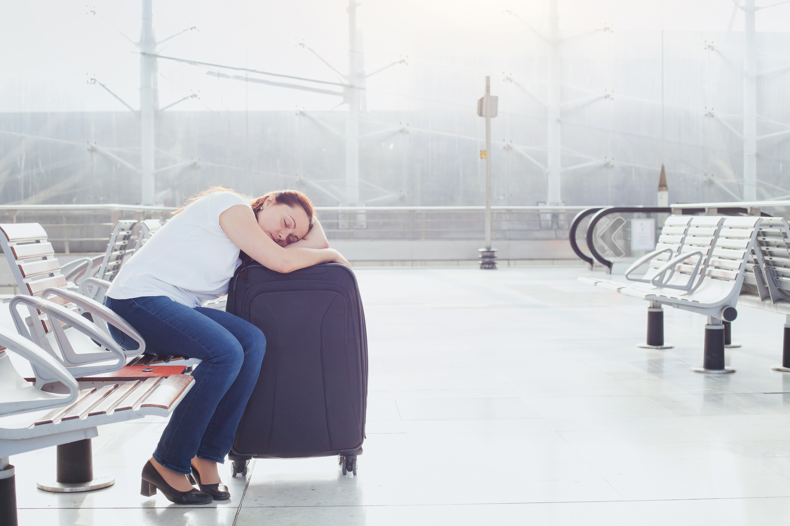 woman-sleeping-suitcase-airport.jpg?mtime=20180710125232#asset:102446